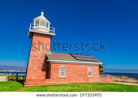 lighthouse  against blue sky - stock photo