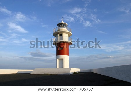 Lighthouse against bright blue sky