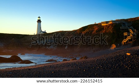 Lighthouse and Beach at Sunset, Yaquina Head, Oregon State, USA
