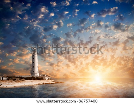 lighthouse and beautiful sunset - stock photo