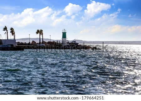 Lighthouse and breakwater in the port of Santa Pola - stock photo