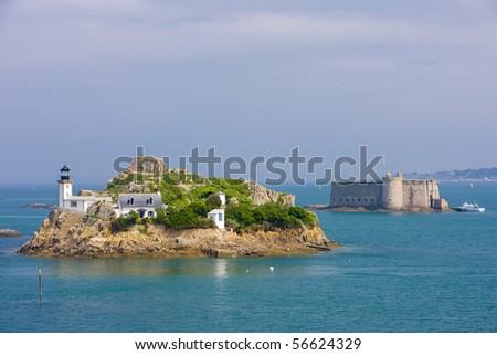 lighthouse and Chateau du Taureau, Pointe de Pen al Lann, Brittany, France - stock photo