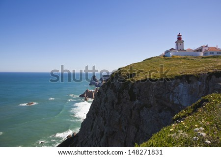 lighthouse and cliffs