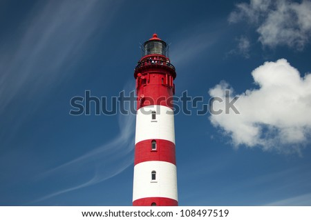 Lighthouse and dunes against beautiful sky at the German North Sea island Amrum, Germany, Europe - stock photo