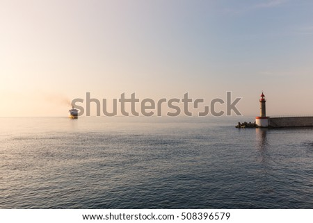 lighthouse and ship on the sea
