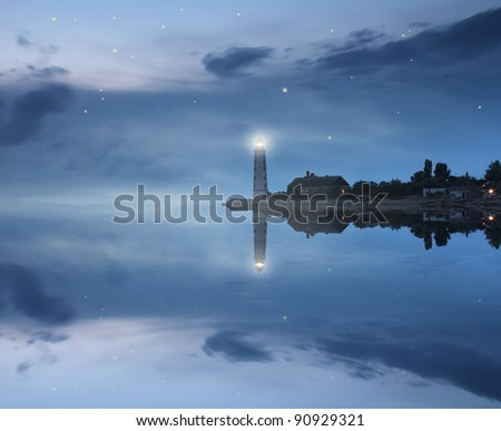 Lighthouse and stars reflecting in sea - stock photo