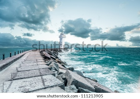 Lighthouse and the waves - stock photo
