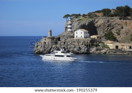 Lighthouse and yacht in Port de Soller, Majorca