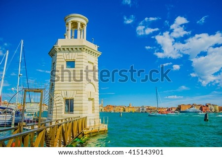 Lighthouse and yachts on the Island of San Giorgio Maggiore, Venice, Italy - stock photo