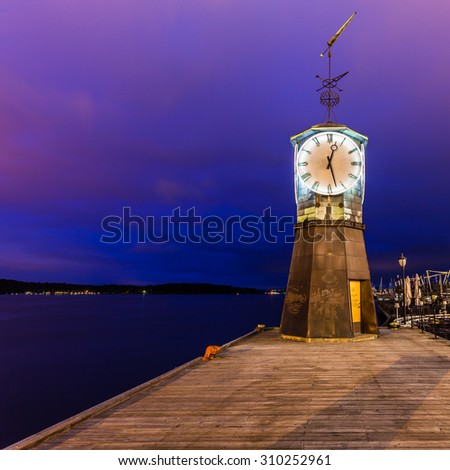 Lighthouse at Aker Brygge in Oslo, Norway. - stock photo