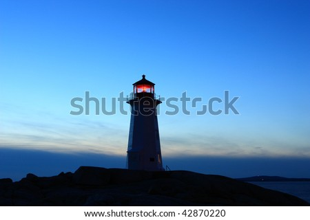 Lighthouse at dusk - stock photo