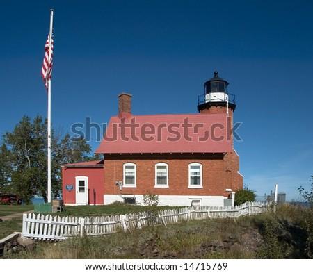 Lighthouse At Eagle Harbor, Michigan's Upper Peninsula - stock photo