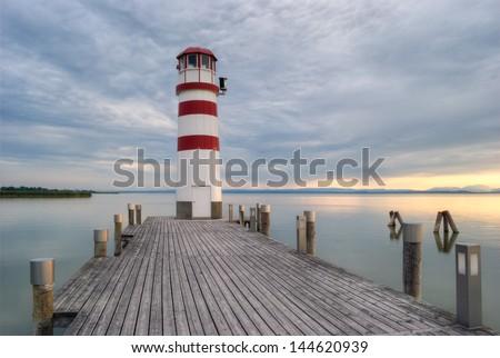 lighthouse at Lake Neusiedl at sunset near Podersdorf, Burgenland, Austria - stock photo