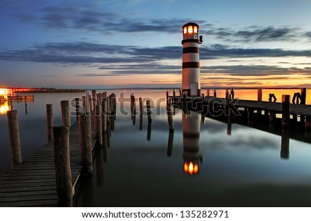 Lighthouse at night in Austria - stock photo