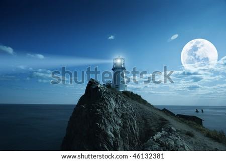 Lighthouse at nighttime. Japanese sea. - stock photo