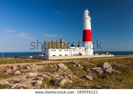 Lighthouse at Portland Bill with blue sky, England. - stock photo
