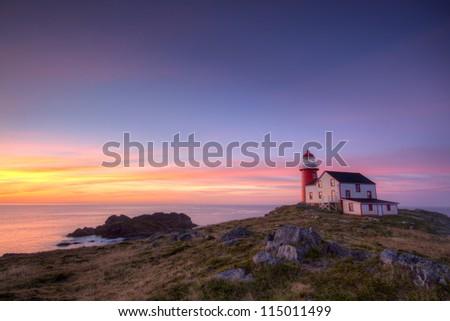 Lighthouse at sunrise. - stock photo