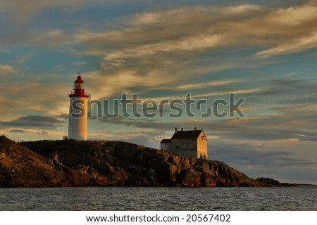 Lighthouse at sunset. - stock photo