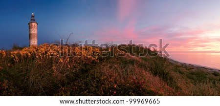 Lighthouse at sunset - stock photo