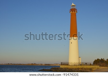 Lighthouse at Sunset Barnegat Light - stock photo