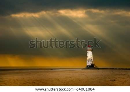 lighthouse at talacre, north wales, uk in the afterglow following a storm at sea - stock photo
