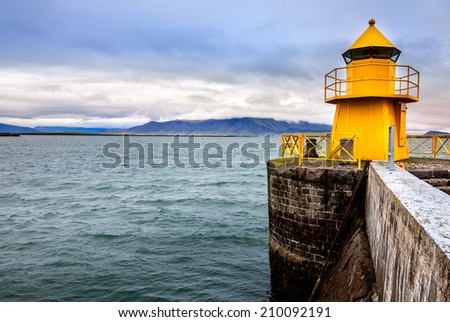 Lighthouse at the entrance to Reykjavik harbor in Iceland - stock photo