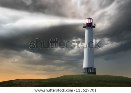 Lighthouse beaming light ray over stormy clouds. - stock photo