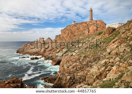 lighthouse Cabo Vilan on the atlantic ocean (Galicia) - stock photo