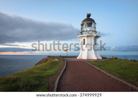 Lighthouse Cape Reinga on the North Island of New Zealand at dusk - stock photo