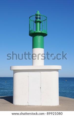 Lighthouse daytime photo. - stock photo