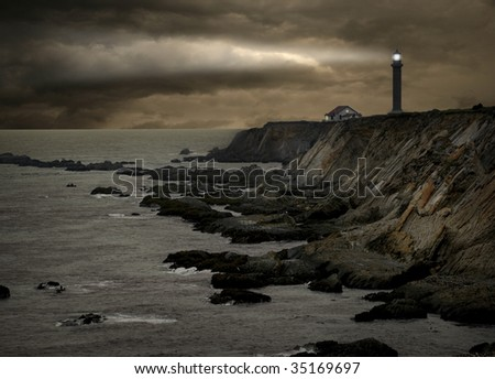 lighthouse during a storm - stock photo