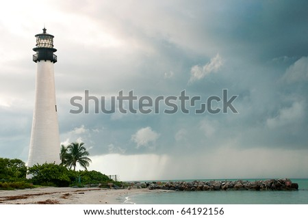 Lighthouse in a cloudy day with a storm approaching - stock photo