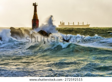 Lighthouse in a storm. - stock photo