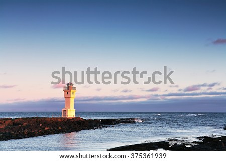 Lighthouse in Akranes, Iceland at sunset with copy-space