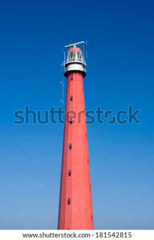 Lighthouse in Holland on the seashore Den Helder  - stock photo