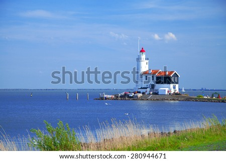lighthouse in Marken is on the coast of the Sea in Europe - stock photo