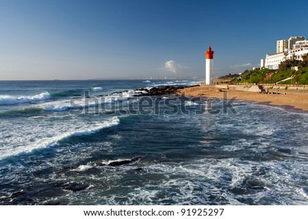 lighthouse in morning sunlight in Umhlanga beach, Durban, South Africa - stock photo