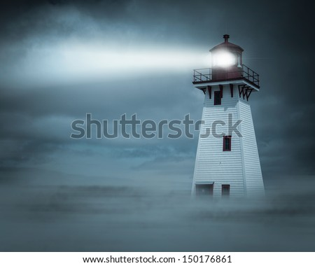 Lighthouse in New Brunswick, Canada,  in fog, mist and clouds at night. - stock photo