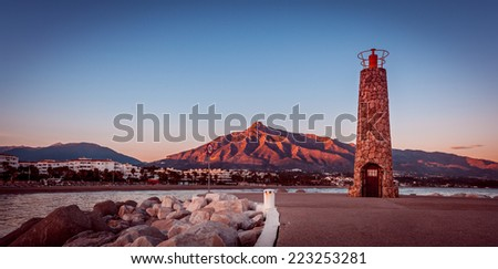 Lighthouse in Puerto Banus near Marbella with vintage effect - stock photo