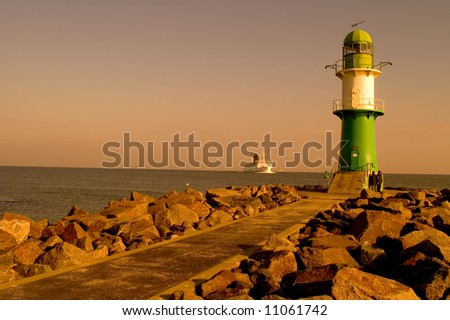 lighthouse in rostock, ferry - stock photo
