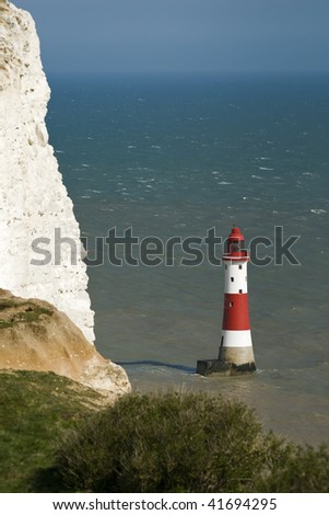 Lighthouse in the English Channel near Beachy Head - stock photo