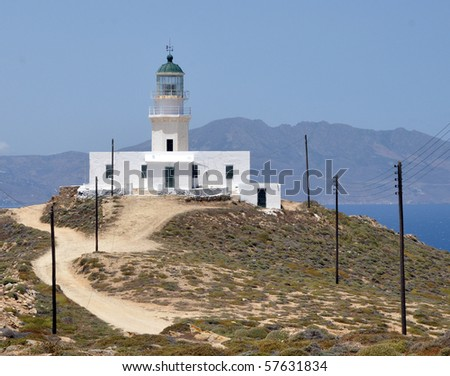 Lighthouse in the hill of Mykonos - stock photo