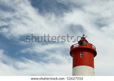 Lighthouse in the sky - stock photo