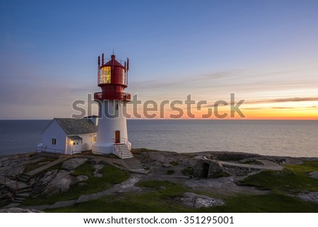 Lighthouse Lindesnes Fyr at sunset on most southern point of Norway, Europe - stock photo