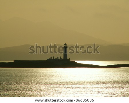 Lighthouse near Mull in Western Scotland - stock photo