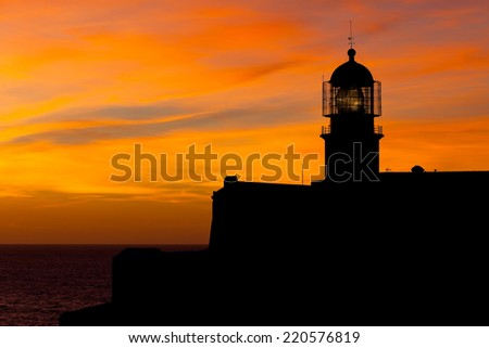 Lighthouse of Cabo Sao Vicente, Sagres, Portugal at Sunset - Farol do Cabo Sao Vicente (built in october 1851) - stock photo