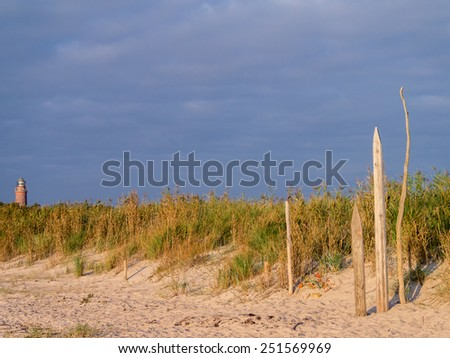 lighthouse of Darss Peninsula in Germany at sunset - stock photo
