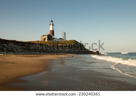 Lighthouse on a beach: Montauk Point, Long Island, New York - stock photo