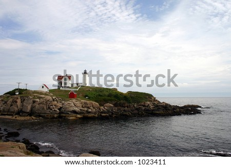 Lighthouse on a Maine shoreline. - stock photo