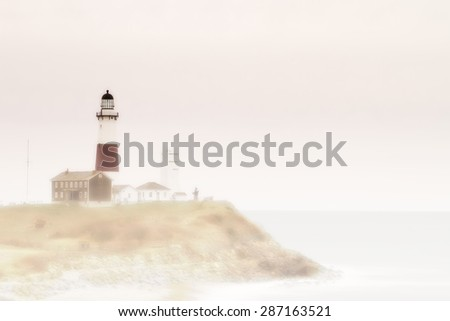 Lighthouse on a rocky shore - stock photo